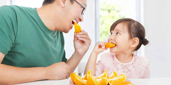 eating oranges for snack